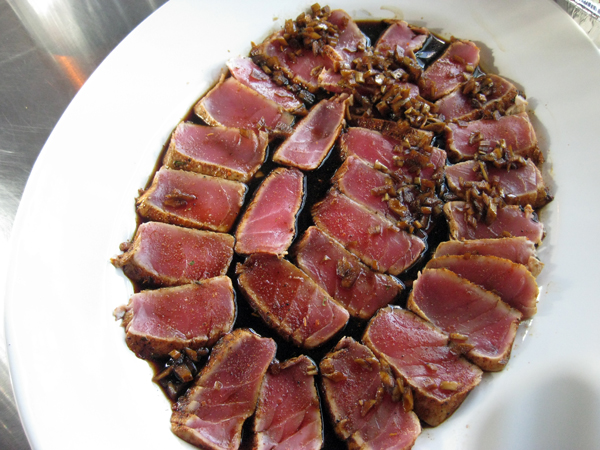 The seared tuna was sliced and sauced.